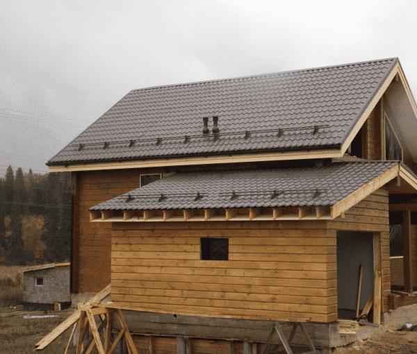 Двускатная крыша для пристройки из бруса
